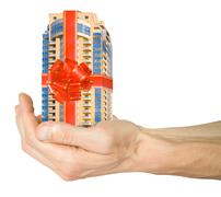 mortgage. hand with house - stock photo
