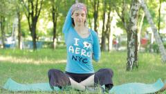 Young Woman Doing Yoga Exercise Sitting in Park, Outdoors HD Stock Footage