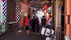 Zoom in to an alleyway in the medina quarter of Marrakesh Stock Footage