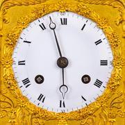 Ancient ornamental golden clock face Stock Photos
