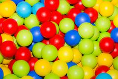 Holiday, children's party games room, a box filled with small colored balls Stock Photos