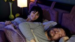 Woman waking up from nightmare in love with sleeping boyfriend at home Arkistovideo