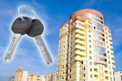loan. key with house on blue sky - stock photo