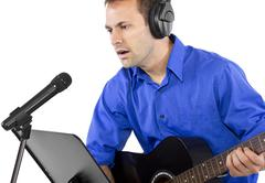 Male Guitar Player in Recording Studio Stock Photos