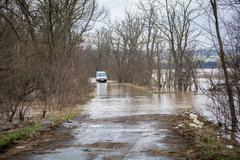 Flood - a natural phenomenon. The car passes through the water - stock photo