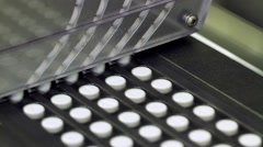 Pills at an packaging line at a pharmaceutical factory - stock footage