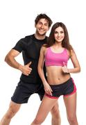 Athletic couple - man and woman with thumb up on the white - stock photo