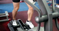 Strong male sports leg on a simulator orbitrek Stock Footage