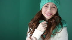 Smiling girl in a turquoise knitted hat posing Stock Footage