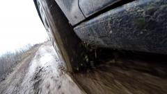 Car's wheels in mud in the forest, off-road. Driving at country road. View from Stock Footage