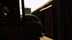 Forklift Truck is Loading Train With Cargo Stock Footage