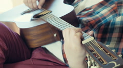 Man playing acoustic guitar slow motion Stock Footage