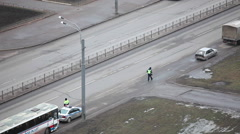 Russian police officer walking to the driver for licence verification, city Stock Footage