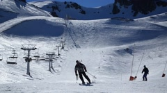 Skiers, snowboarders and chair lift in a ski resort Stock Footage