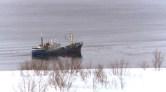 Ship winter sailing on the river along the shore Stock Footage