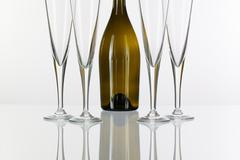 Four  champagne glasses on a glass table Stock Photos