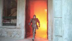 Stock Video Footage of Knight rushes out the door of the palace in the fire