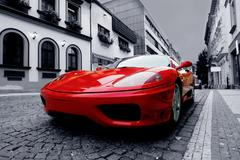 beautiful speed red sportcar on the road - stock photo
