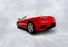 Stock Photo of beautiful speed red sportcar on the road