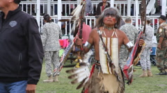 Elder with eagle head dances at pow wow Stock Footage