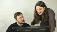 Young office worker couple flirting with each other at computer Stock Footage