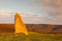 Menhir on the hill at sunset in Morinka village Stock Photos