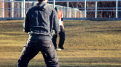 Men playing frisbee on the grass - stock footage