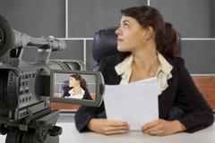 Filming Female Reporter Kuvituskuvat
