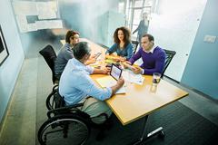 Business people using digital tablets in office meeting Stock Photos