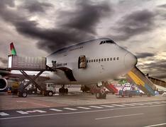 Loading the plane - stock photo