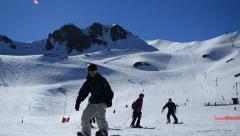 Skiers and snowboarders in a ski resort Stock Footage