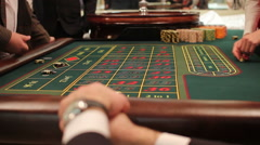 dealer picks up  losers chips in the game of roulette - stock footage