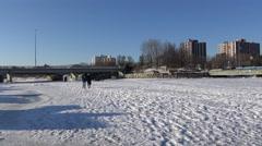 People walking on frozen river/ 4k Winter Landscape footage 2015 Stock Footage