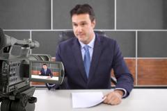 Reporter on TV Stock Photos