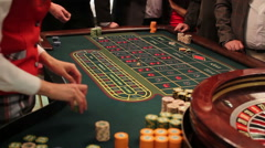 Dealer pays out for winners in roulette game Stock Footage