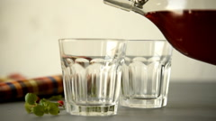 Pouring lingonberry drink Stock Footage
