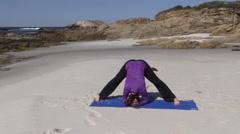 Yoga Practice on the Beach Stock Footage