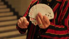 Magician shows tricks with cards Stock Footage