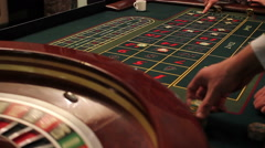 Roulette players place their bets, then the camera is transferred to the wheel Stock Footage