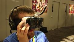 Virtual Reality VR Goggles and Gaming: Many gamers with VR goggles - stock footage