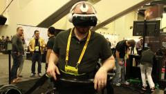 Virtual Reality Gaming: Morpheus Goggles Guy Runs on VR platform with goggles Stock Footage