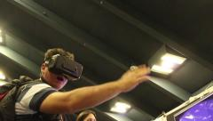 Oculus Rift Virtual Reality Gaming Technology: VR goggles and bluetooth trigger Stock Footage