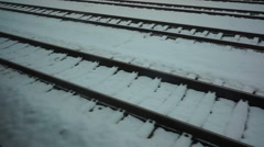 Snow covered rail track, photographed from a driving train Stock Footage