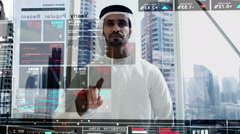 Middle Eastern business male technology online touchscreen trade stocks data - stock footage