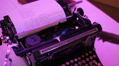 Old typewriter in discolights Stock Footage