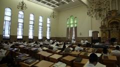 Yeshiva students at Ponevezh Yeshiva reading the Megillah - stock footage