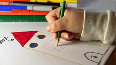 child drawing with colors with felt-tip pen - stock footage