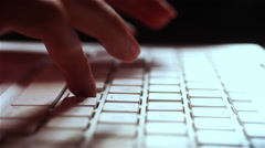 hands of young attractive woman Typing on keyboard of a White Computer Laptop - stock footage