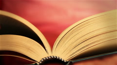 Woman opens a book and turns the pages Stock Footage
