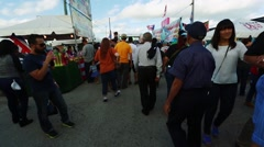 Crowd of people walking around during festival. Puerto Rican flags Stock Footage